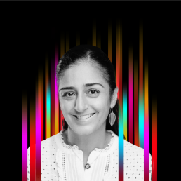 On the middle of a black background is a row of colourful vertical stripes'. In the centre is a black and white profile photo of TEDx speaker Ghino Parker superimposed on top.