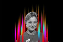 On the middle of a black background is a row of colourful vertical stripes'. In the centre is a black and white profile photo of TEDx speaker Sophie Lodge superimposed on top.
